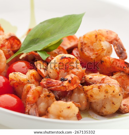 Appetizers -  Fried Tiger Shrimps with Garlic and Cherry Tomato - stock photo