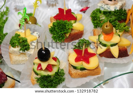 Appetizers on sticks - stock photo