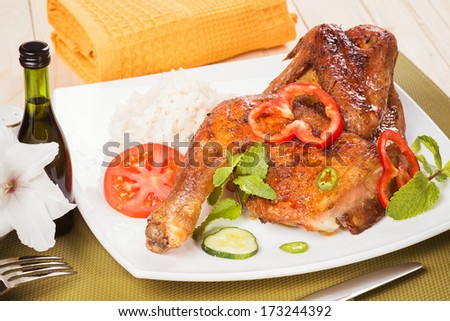 Appetizing baked chicken with fresh vegetables - stock photo