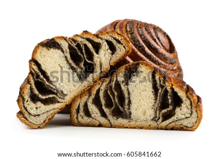 Appetizing bun with poppy seeds isolated on white background