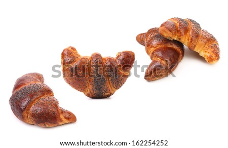 Appetizing croissants with poppy. Isolated on a white background.