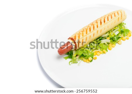 Appetizing French hot dog on green gourmet isolated on white - stock photo