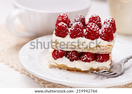 Appetizing french millefeuilles raspberry dessert  - stock photo