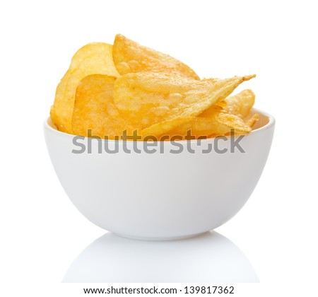 Appetizing, golden chips in the faience bowl, isolated on white - stock photo