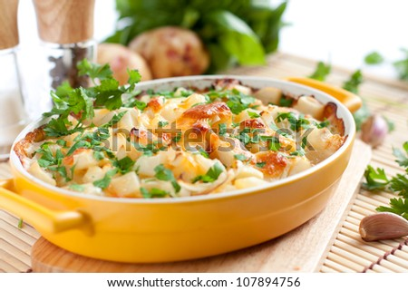 Appetizing gratin  in the yellow form for baking - stock photo