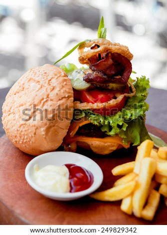 Appetizing hamburger with cheese and vegetables. Barbecue. restaurant - stock photo