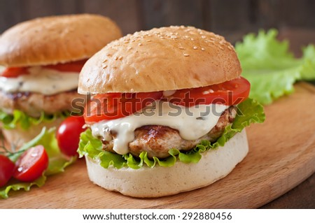 Appetizing hamburger with chicken burger and sauce Tartar - stock photo