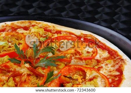 Appetizing italian pizza with tomatoes, paprika, onion on steel background - stock photo