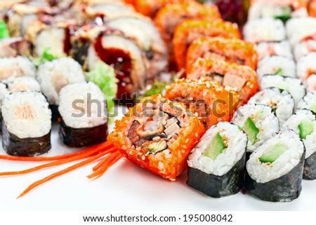Appetizing Japanese sushi , focus on a foreground - stock photo