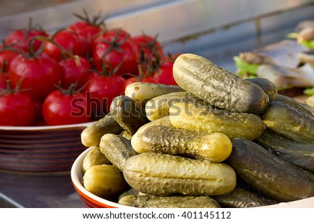 Appetizing Pickled canned vegetables cucumbers and tomatoes. Selective focus - stock photo