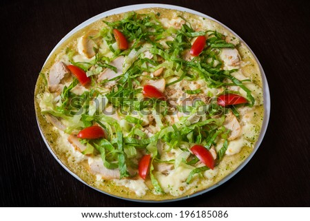 Appetizing pizza with mozzarella cheese and meat of chicken