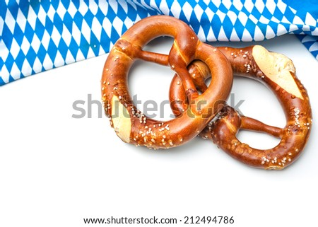 Appetizing pretzels with a bavarian flag on white background - stock photo