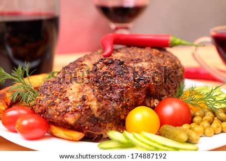 Appetizing roasted fillet of pork with spices and vegetables