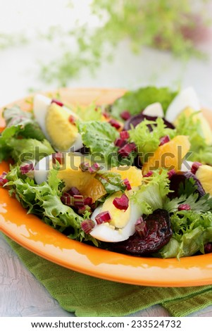 appetizing salad with vegetables, eggs and orange - stock photo