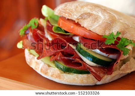 Appetizing sandwich with ham and vegetables