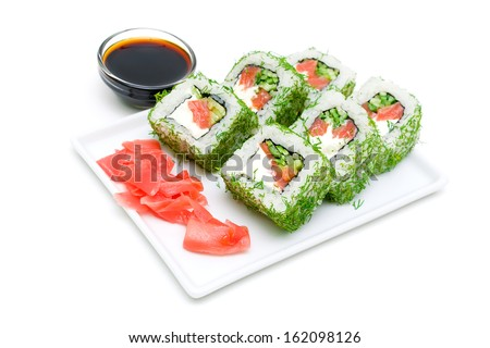 Appetizing tasty Japan rolls on a plate isolated on a white background. horizontal photo. - stock photo