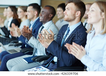 Applauding after lecture - stock photo