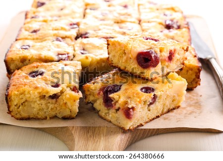 Apple and berry traybake slices on board - stock photo