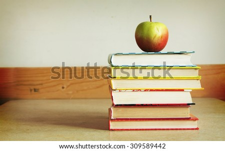 Apple and books - stock photo