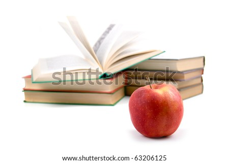 Apple and books isolated on a white background