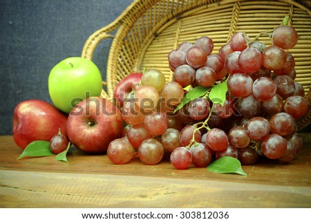 Apple and grape on wood table , still life food vintage tone