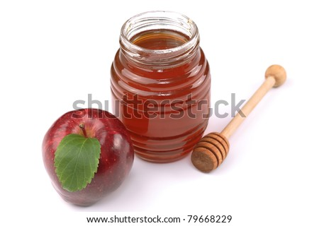 Apple and honey - a traditional food for the jewish holiday of Rosh Hashana - stock photo