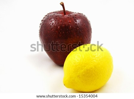 apple and lemon isolated on a white background