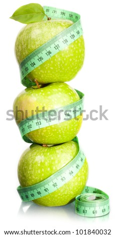 Apple and measurement. A slender figure. - stock photo