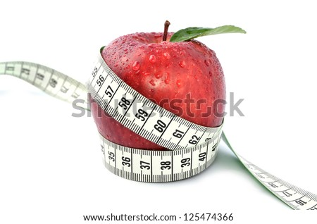 Apple and measuring tape - concept for weight loss