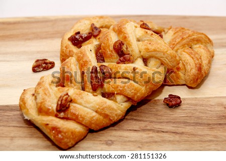 Apple and Pecan plait danish pastry  - stock photo