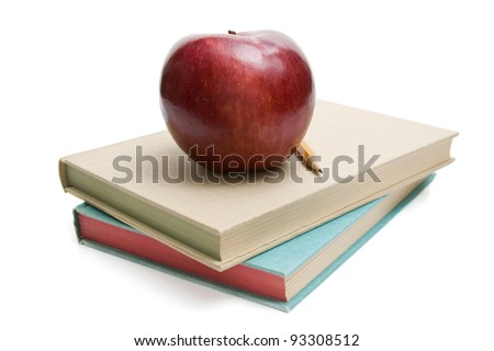 Apple and pencil on a stack of books - stock photo