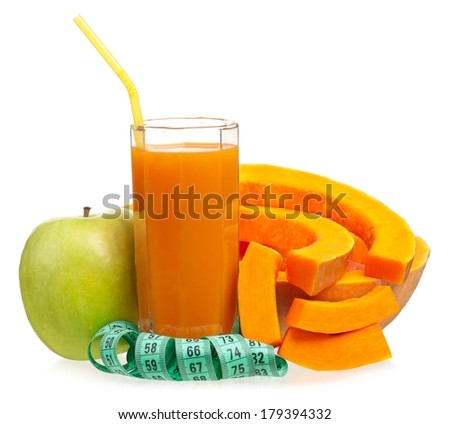 Apple and pumpkin juice with tape measure isolated on white background - stock photo