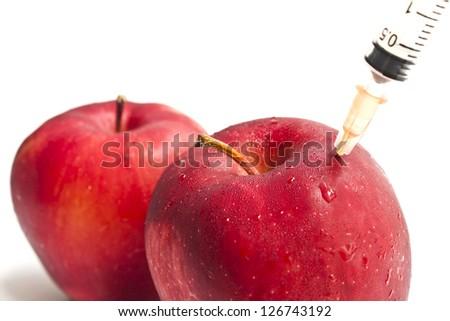 Apple and syringe - stock photo