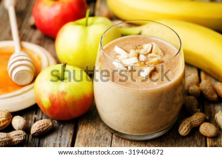 Apple banana peanut butter smoothie. the toning. selective focus - stock photo