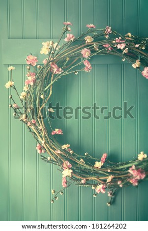 Apple blossom wreath hanging on coat hook - stock photo
