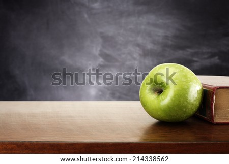 apple book and desk   - stock photo