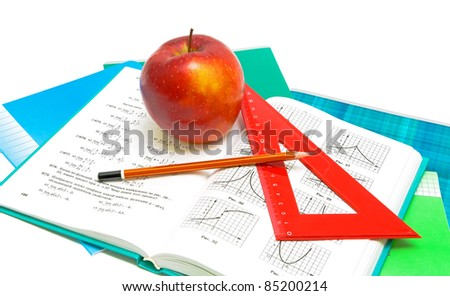 apple, book and ruler closeup on white background - stock photo