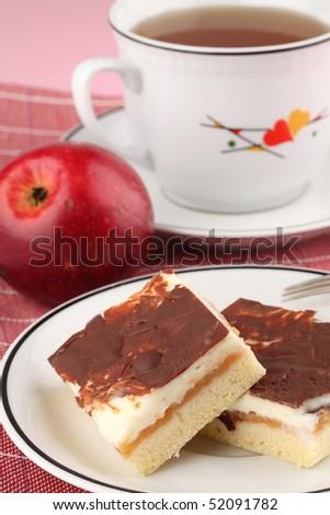 Apple cake with vanilla cream, apple and tea in background - stock photo