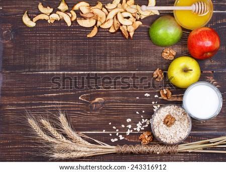 Apple Chips, Fresh Apples, Honey, Milk, Oat Flakes and Walnuts. Still Life. - stock photo