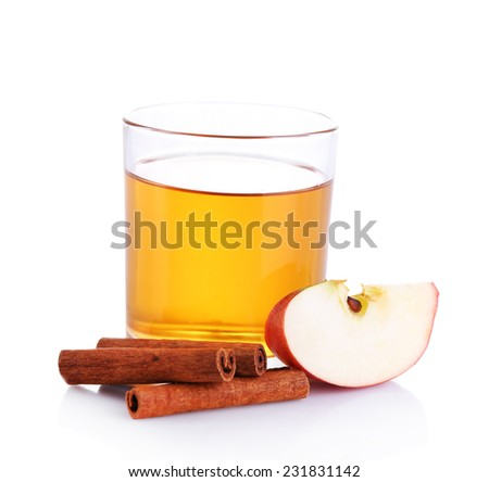 Apple cider with cinnamon sticks, isolated on white - stock photo