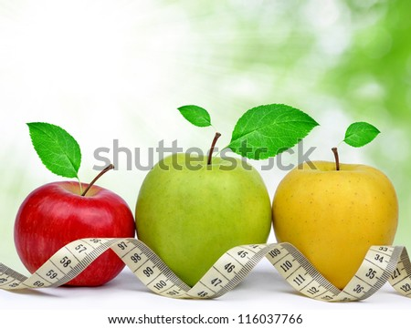 apple collection with measuring tape - stock photo