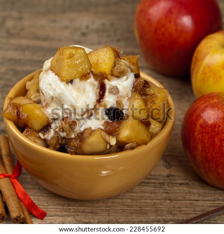 Apple crisp with ice cream. Selective focus. - stock photo