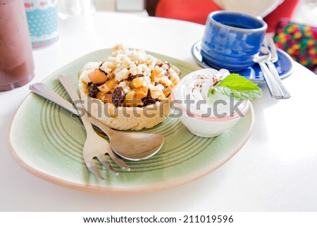 apple crumble with whipped cream.in tea time. - stock photo