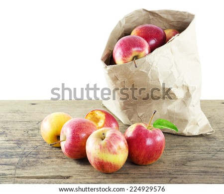 Apple fruit in recycle paper bag on wood table isolate white background - stock photo