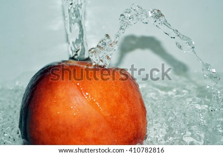 Apple in the water and splashes - stock photo