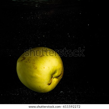 Apple in water on a black background.