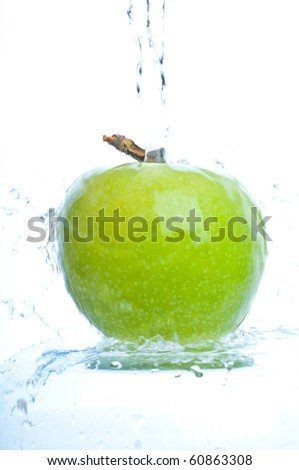 apple  into water splash on white