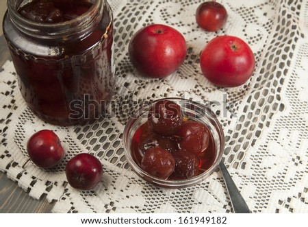 Apple jam in a bowl on a wooden table