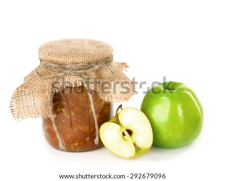 apple jam in a glass jar and fresh green apple on a white background - stock photo