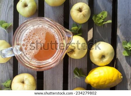Apple juice, near apples, mint and lemon - stock photo